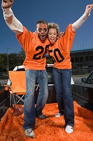 Cheering couple on tailgate