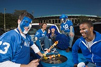 Tailgating fans grilling kebabs