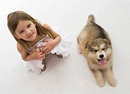 Smiling girl with puppy
