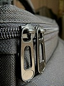 Close-up of bag zip