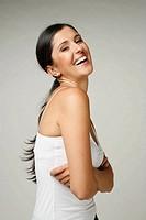 Beautiful Latin woman smiles at the camera