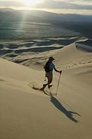 Woman hiking through desert