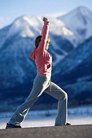 Woman doing stretches by mountains