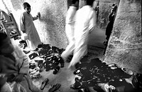 Near the Nile, Gebel el Teir, shoes before the entrance of the church