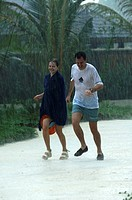 Olhuveli Resort, a couple on a romantic holiday to sunny Maldives is caught in a tropical rainstorm and running for shelter