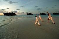 Maldives, yoga class on the beach of the Sonevagili resort