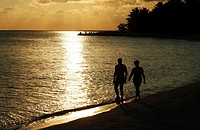 Maldives, couple walking in the twilight