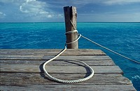 Rope on wooden deck at ocean