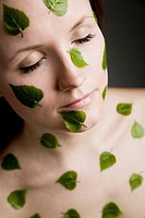 Birch leaves on woman´s skin  Finland