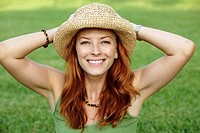 Smiling girl in a straw hat