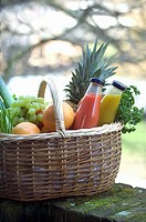 Fresh fruit, vegetables and juice in shopping basket