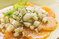 Fennel salad on orange slices close-up