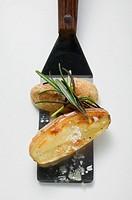Rosemary potatoes on spatula