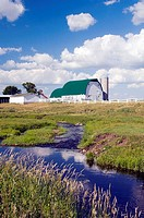 A dairy farm and country stream near Wadena, Minnesota, USA