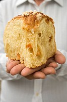 Hands holding piece of yeast cake