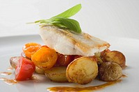 Fish fillet with fried potatoes and cherry tomatoes