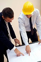 architect and engineer with plan