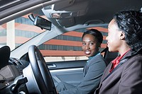 Two businesswomen in car