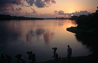 Scenic View of People in the River at Sunset  Rufiji River, Tanzania