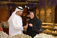 Smiling Arab Husband and Wife Shopping in Bakery  Dubai, United Arab Emirates