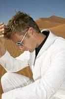 Man in a White Suit and Sunglasses in the Desert  Namibia