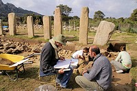 Working on the archeological site of  Stantari, at Cauria. Corsica. France