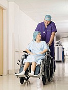 Doctor pushing patient in a wheelchair (thumbnail)