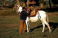Pantanal Cowboy,Pantaneiro,Horse,Pantaneiro Horse,Pantanal,Brazil,saddle his Horse