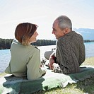Couple relaxing by a lake