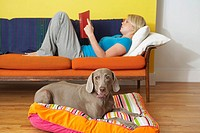 Woman and weimaraner relaxing