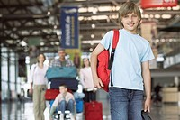 Boy standing in airport