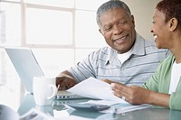 Couple preparing finances at home
