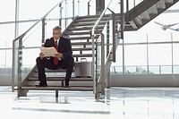 Businessman sitting on stairway