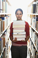 College student with stack of books