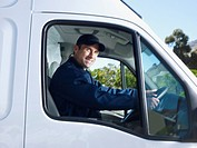 Delivery person driving van