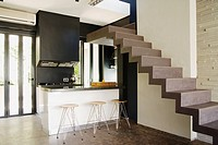 Modern stairs over kitchen