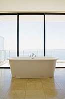 Modern bathroom with bathtub and large windows