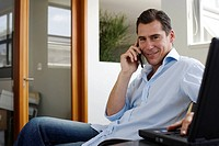 Businessman on his mobile phone in office