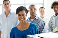 Businesswoman standing with coworkers smiling