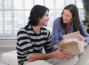 Couple opening a box smiling