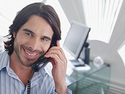 Businessman on telephone in modern office