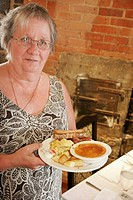 Canada, Montreal, Vieux Montreal, Rue Saint Paul, Restaurant du Vieux Port Montreal, senior woman, food, dining