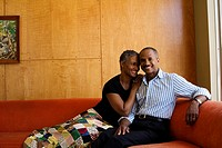 Couple on sofa in modern home (thumbnail)