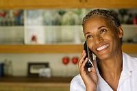 Woman on cordless telephone smiling