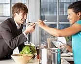 Woman feeding man with a spoon (thumbnail)
