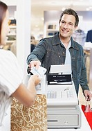 Man paying for items at a cashier in store