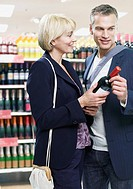 Couple shopping for wine