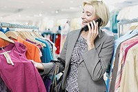 Woman shopping while on cellular phone