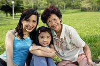 Three generations of women in park
