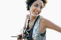 Woman holding handlebar smiling
